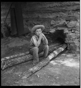 """Ten year old son of tobacco sharecropper can do a """"hand's work"""" at tobacco harvest time. Granville County, North Carolina"""