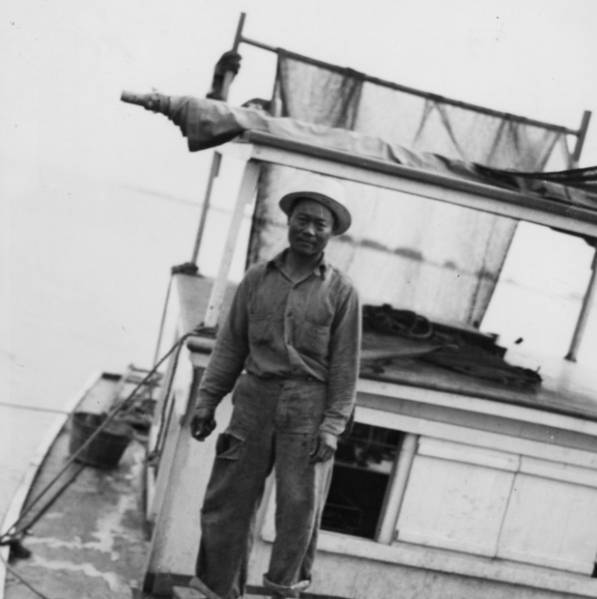 """Man on fishing boat, 1940s"" (State Library of Louisiana)"