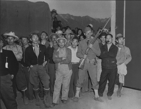 "Japanese Internees and Guard ""Greet"" New Arrivals at Manzanar (War Relocation Authority)"