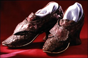 "When she married Colonel George Washington on January 6, 1759, Martha Dandridge Custis is said to have worn a ""petticoat of white silk interwoven with silver,"" a gown of ""deep yellow brocade with rich lace in the neck and sleeves,"" and these lavishly embellished shoes of ""purple satin with silver trimmings."""